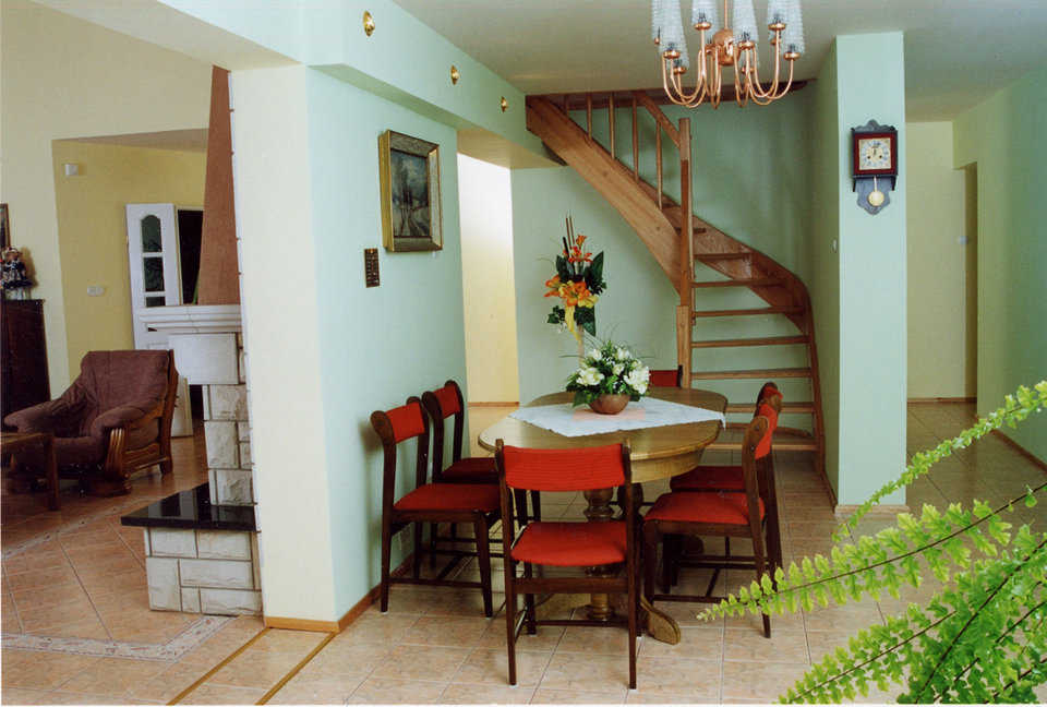 Dining area — Walls done in a kiwi green add warmth to the dining area.