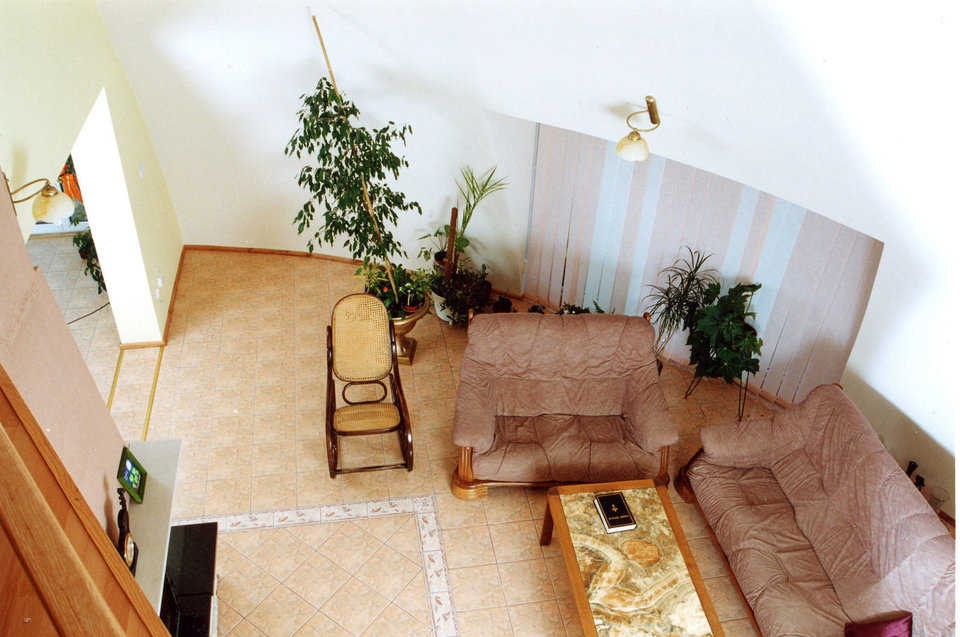 Living area — It has a ceramic tile floor and walls painted a warm gray.