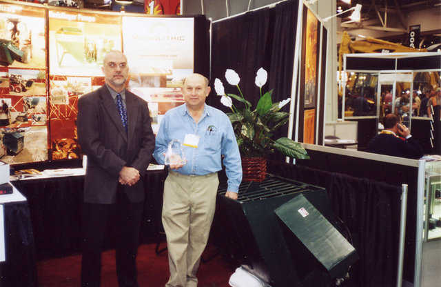 Award — In 2002, Rod Sutton (left), Editor In Chief of Construction Equipment Magazine, presented Blaine Green, Monolithic Equipment Manufacturing Division Manager, an award for the design of the Monolithic Portable Concrete Mixer.