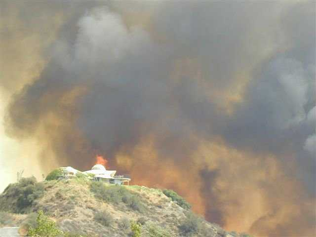 Disastrous Flames — They threatened beautiful Vista Dhome on the afternoon of August 11, 2002.