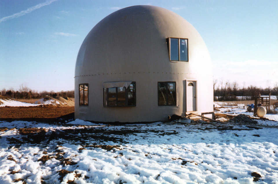 No eave — Without its eave, the dome looks bare. The eave definitely adds appeal.