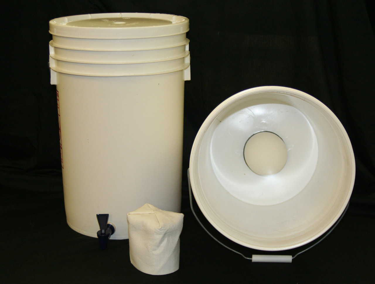 The Just Water Ceramic Drip-Filter — Assembling the Just Water Ceramic Drip-Filter only requires 2 plastic, same-size containers with lids and a tool that will cut a hole in plastic.
