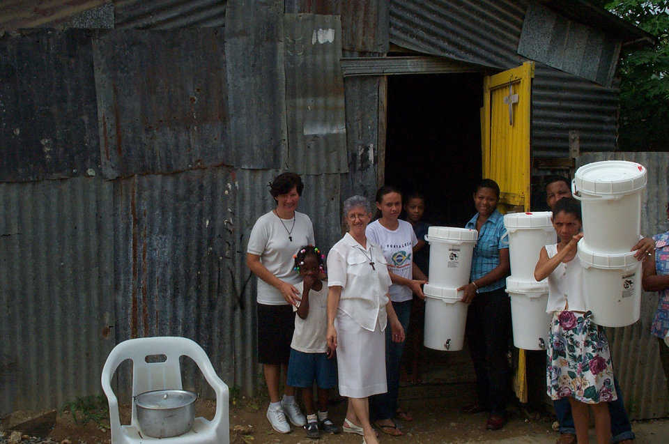 Helping hands — A lady with the Catholic Disaster Team distributes water filters in the Dominican Republic.