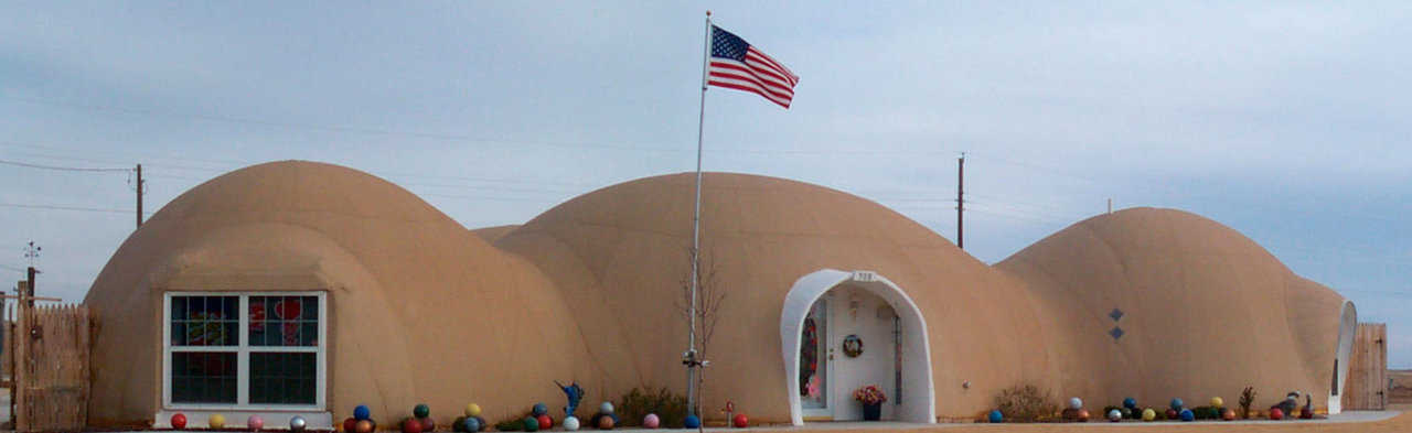 Monolithic Dome home in Shamrock, TX — In 2000, Shirley and Don Tuttle moved into their just-completed, four-dome home and began shopping for homeowners insurance that would take into account the durability and survivability of their Monolithic Domes. Their efforts netted a savings of more than $600.