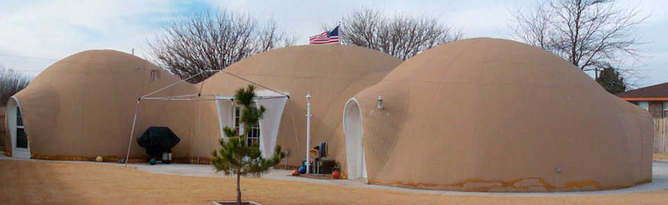 Three-dome home and a dome-garage — The Tuttles' 2,600-square-foot home consists of a 37-foot diameter dome for the kitchen and great room and two 24-foot diameter domes for bedrooms, bathrooms and office. Their fourth dome shelters their car.