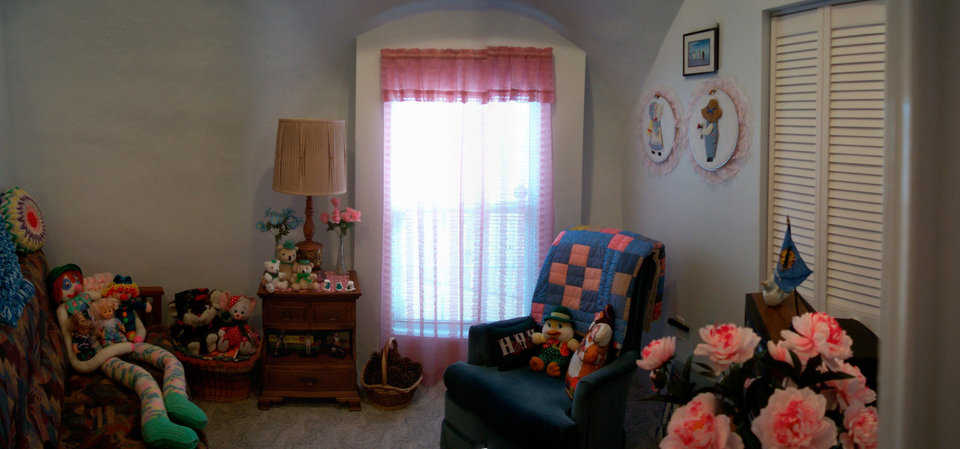 Guest bedroom — It comfortably accommodates and displays Shirley's large collection of stuffed character dolls.