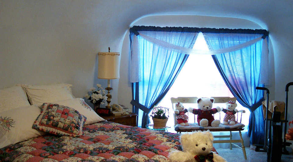 Master bedroom — An assortment of Teddy Bears adds to the comfortable ambiance of this room.