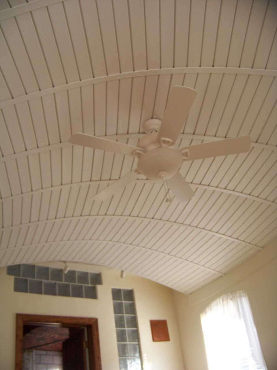 Cool! — The fan contributes comfort while the ceiling it hangs from contributes beauty.