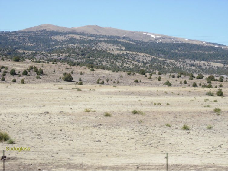 Image 1 — Shield volcano in north-east New Mexico with deep basalt deposits.