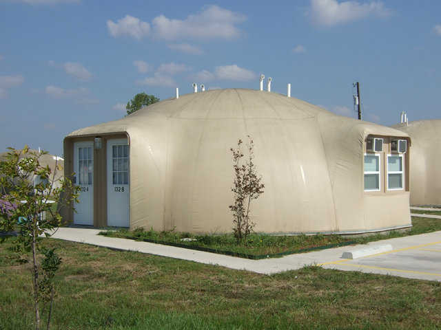 The Oberon Four-Plex — It's a Monolithic Dome that is an oblate ellipse, with a diameter of 32 feet and a height of 12 feet.