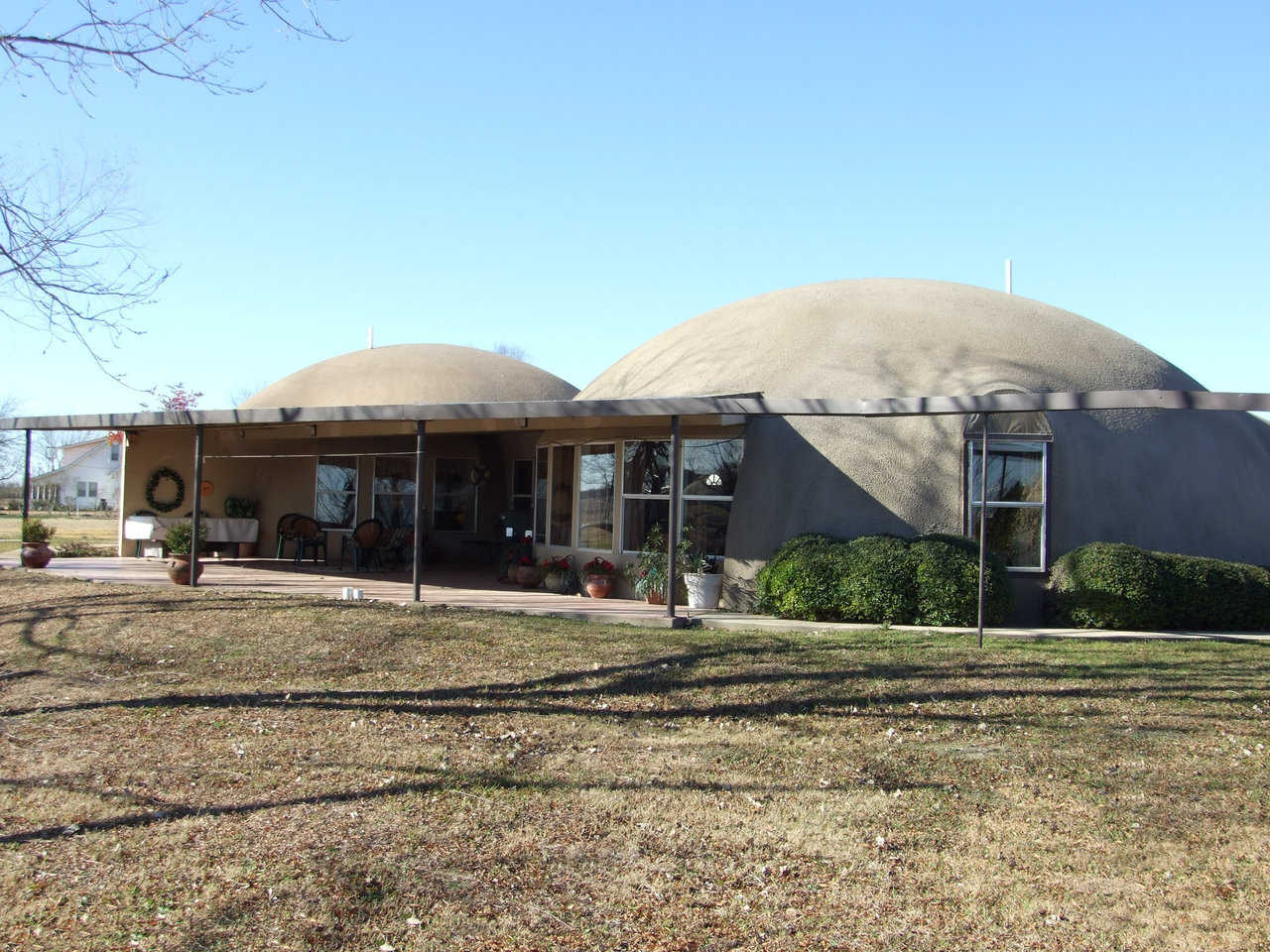 Charca Casa in Italy, Texas — Judy and David South's home, Charca Casa, was designed and constructed as a duplex of two connected domes, each with a diameter of 40 feet. Since its construction in 1994, Charca Casa has beautifully survived several horrific, typically Texas wind storms and twisters.