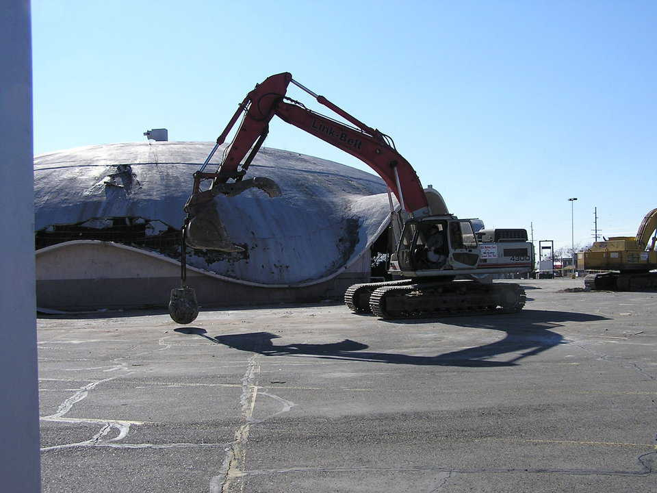 Demolition — Demolition of the Ream's Turtle took two track-hoes, one equipped with a 5000-pound wrecking ball that continually circled the dome, bashing its concrete.