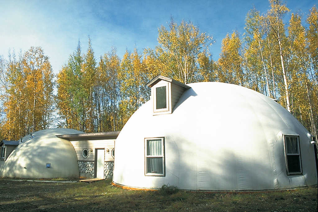 Morrisetts' Monolithic Dome Dream Home — It's on a 2-1/2-acre site in a forested area of Anchorage, Alaska.