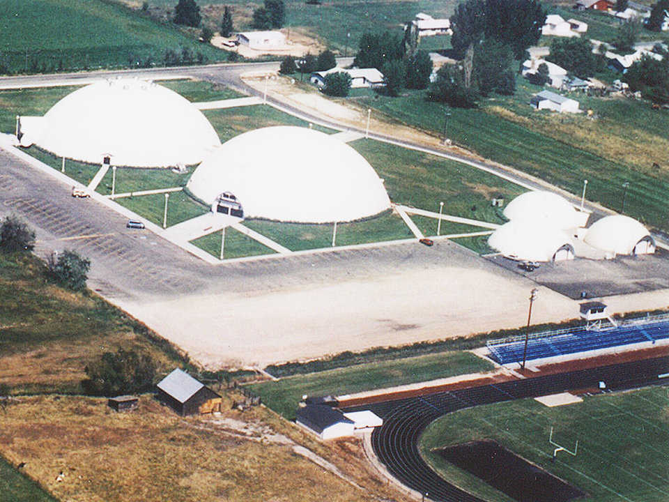 Five Monolithic Domes — Emmett's 900 students use two 180-foot diameter domes that house classrooms and a gymnasium. The three smaller domes function as woodworking, metal and auto shops.