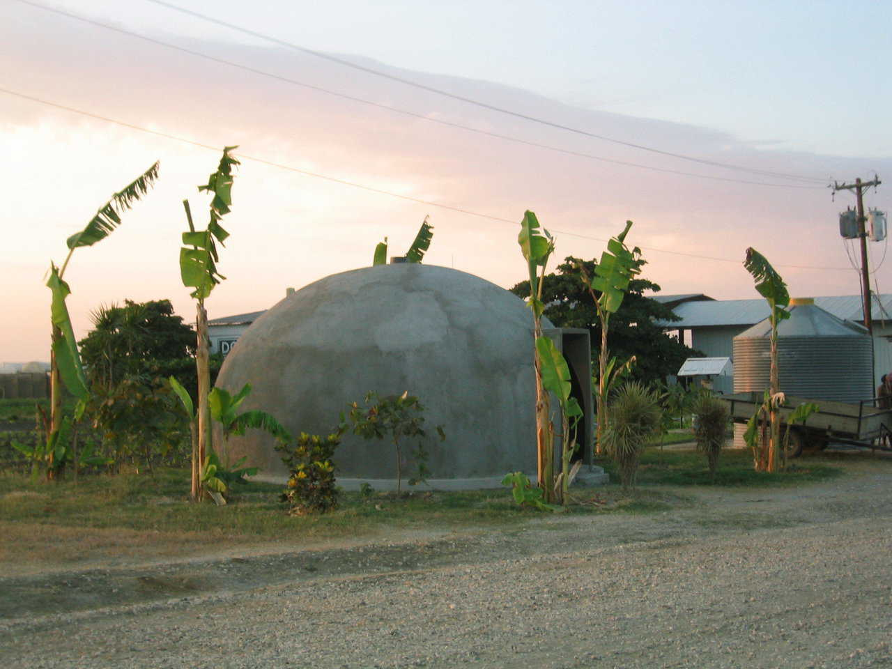 Ecoshells in Haiti — This EcoShell, located in Haiti, provides protection from hurricanes and infestation. A standard mud hut measures 160 sf. This EcoShell is twice the size – measuring 314 sf, yet costs the same to construct.