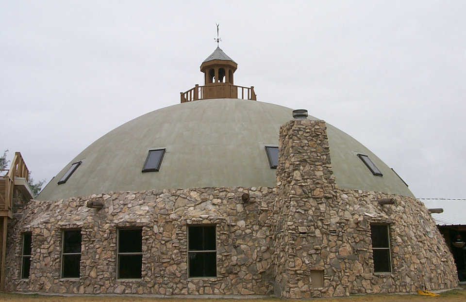 Echoing its environment — Antelope Springs Ranch in Blackwell, Texas has an exterior partially covered in native rock.