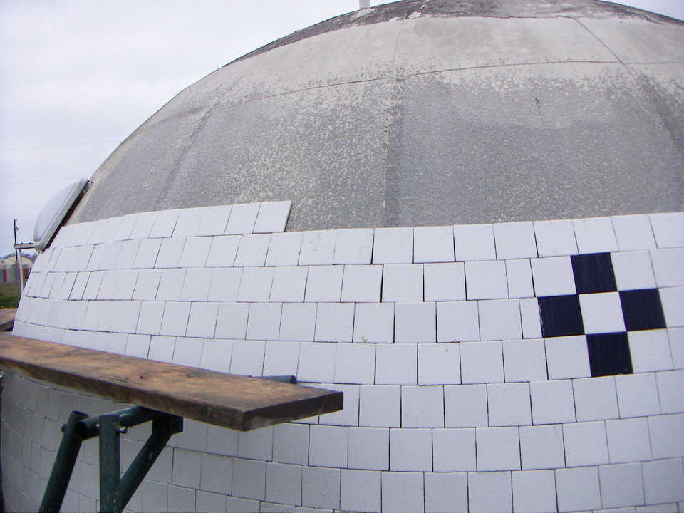 Circular Pattern — Four-inch square tiles were installed, with reference to a level line around the dome's base, in a circular pattern, from bottom to top, on a 16.5' diameter Monolithic Dome at the Monolithic Dome Institute.