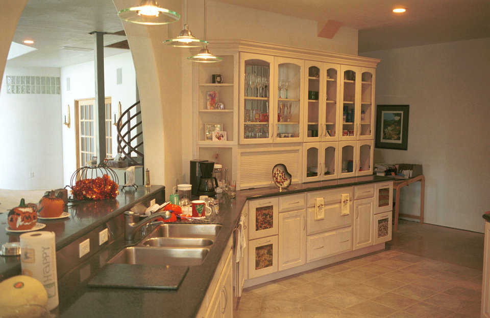 Spacious kitchen — Excess storage makes this kitchen extremely functional. The archway overlooks the central living area.