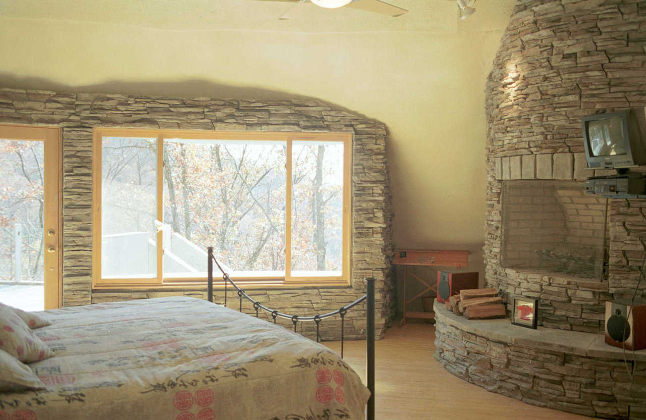Romantic! — Master suite has a fireplace! It shares a chimney with the lower-level fireplace but requires a separate flue. A partial wall divides bath and bedroom. Electronically controlled skylight provides star-gazing opportunities and features a rain sensor that sutomatically closes the skylight.