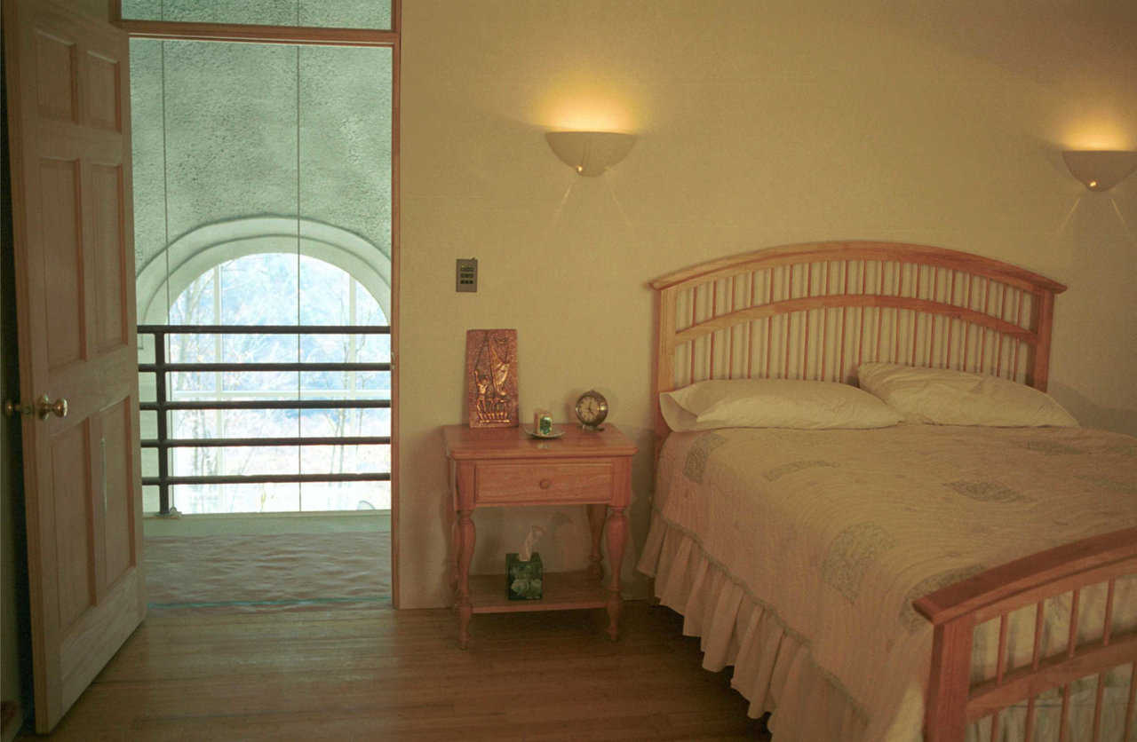 Guest bedroom — It's entered off the balcony that overlooks the central living area.