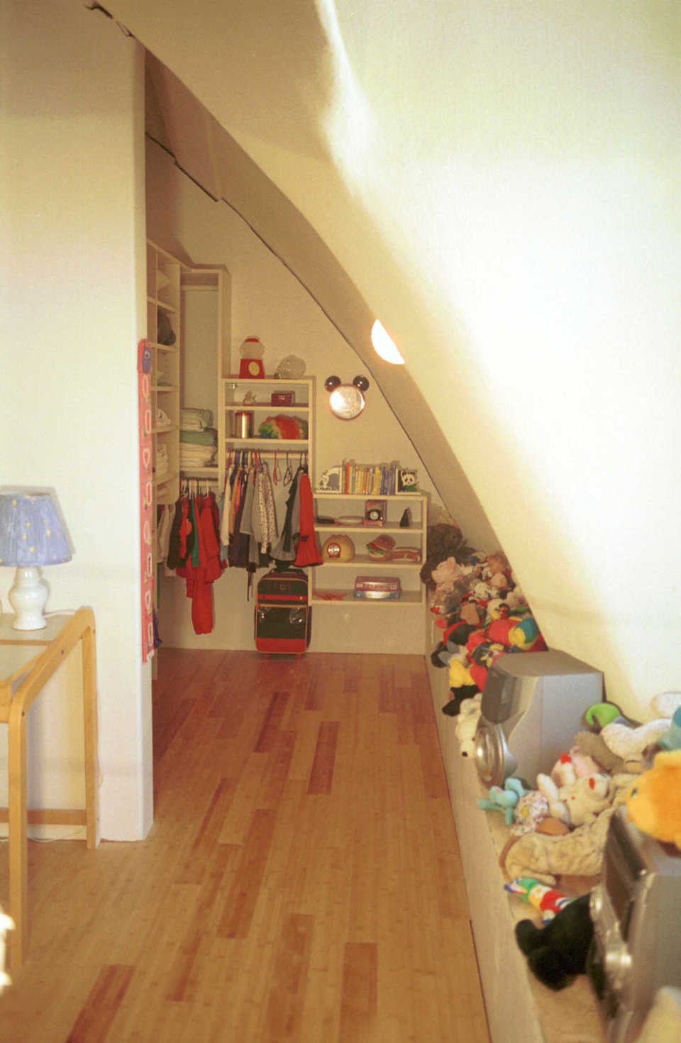 Meili's stuff — She has ample storage space for clothes, books and toys.
