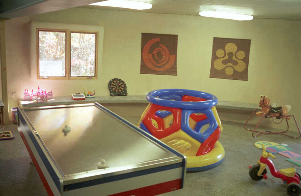 Playroom — The playroom has concrete benches hanging off the dome wall (cantilever). Floor features a polymer overlay, with color and pattern.