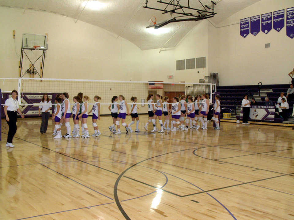 Girls' Volleyball — Grand Meadow's gym features pull-out bleachers, locker rooms, a regulation size basketball court and two cross-court practice goals.