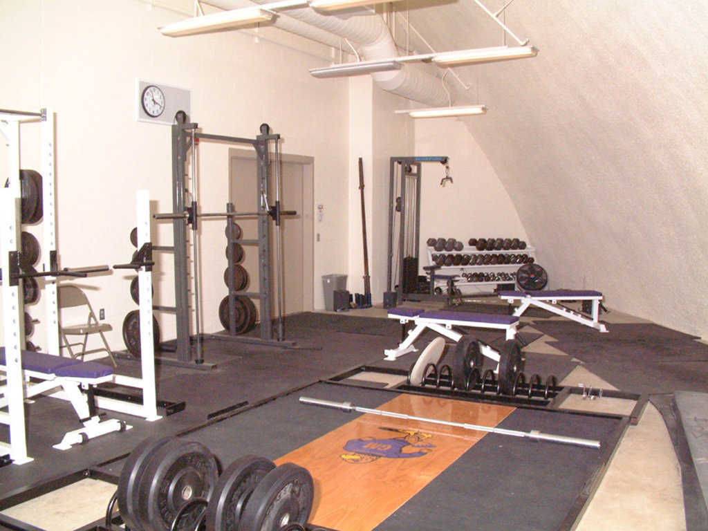 Weight Room — It's located behind the bleachers.