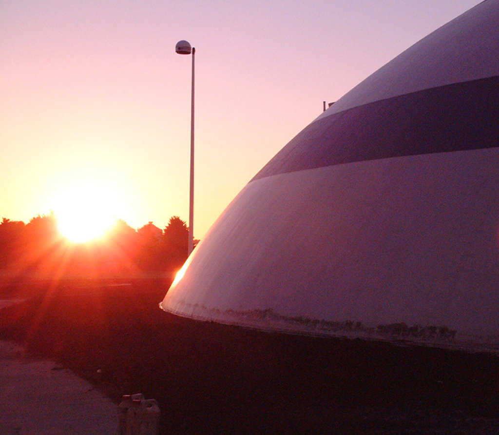 Sunset at Grand Meadow — In 2007, Grand Meadow Superintendent Brown told the Minnesota Legislature about the low energy costs of their Monolithic Dome facility.