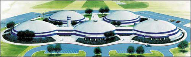 Grand Meadow School — In 2001, Grand Meadow ISD in Minnesota celebrated a ground breaking for its new school campus with five Monolithic Domes.
