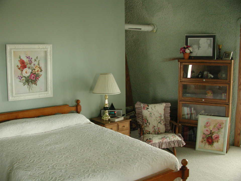 Cozy bedroom — It's decorated with floral prints.