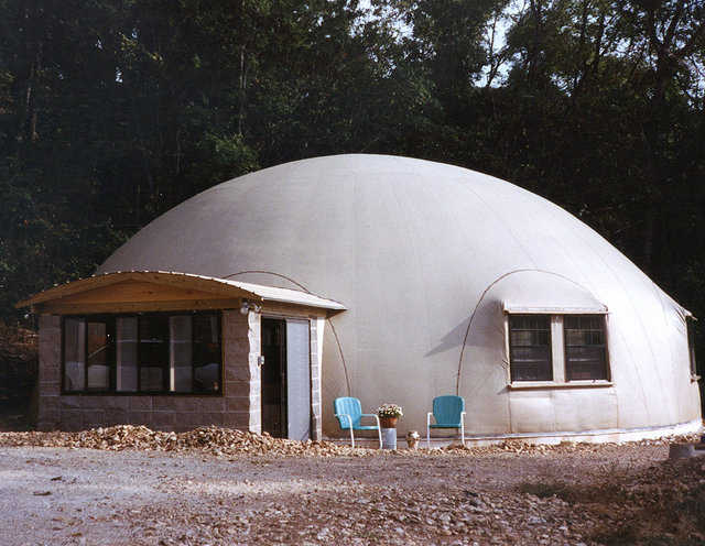 Home at last! — After many weather delays, Don Pass and Ron Boswell completed this 50′ × 20′ Monolithic Dome home. They finished the dome interior in just 6 weeks, including all cabinet work, floor coverings and sheet rock.