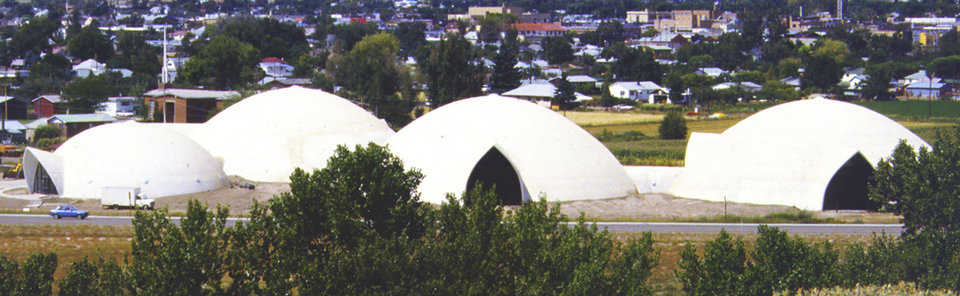Gothic arches — Four interconnected Monolithic Domes serve as the Public Works Complex for the city of Price, Utah. Cylinder openings connect the domes and give each a Gothic entryway.
