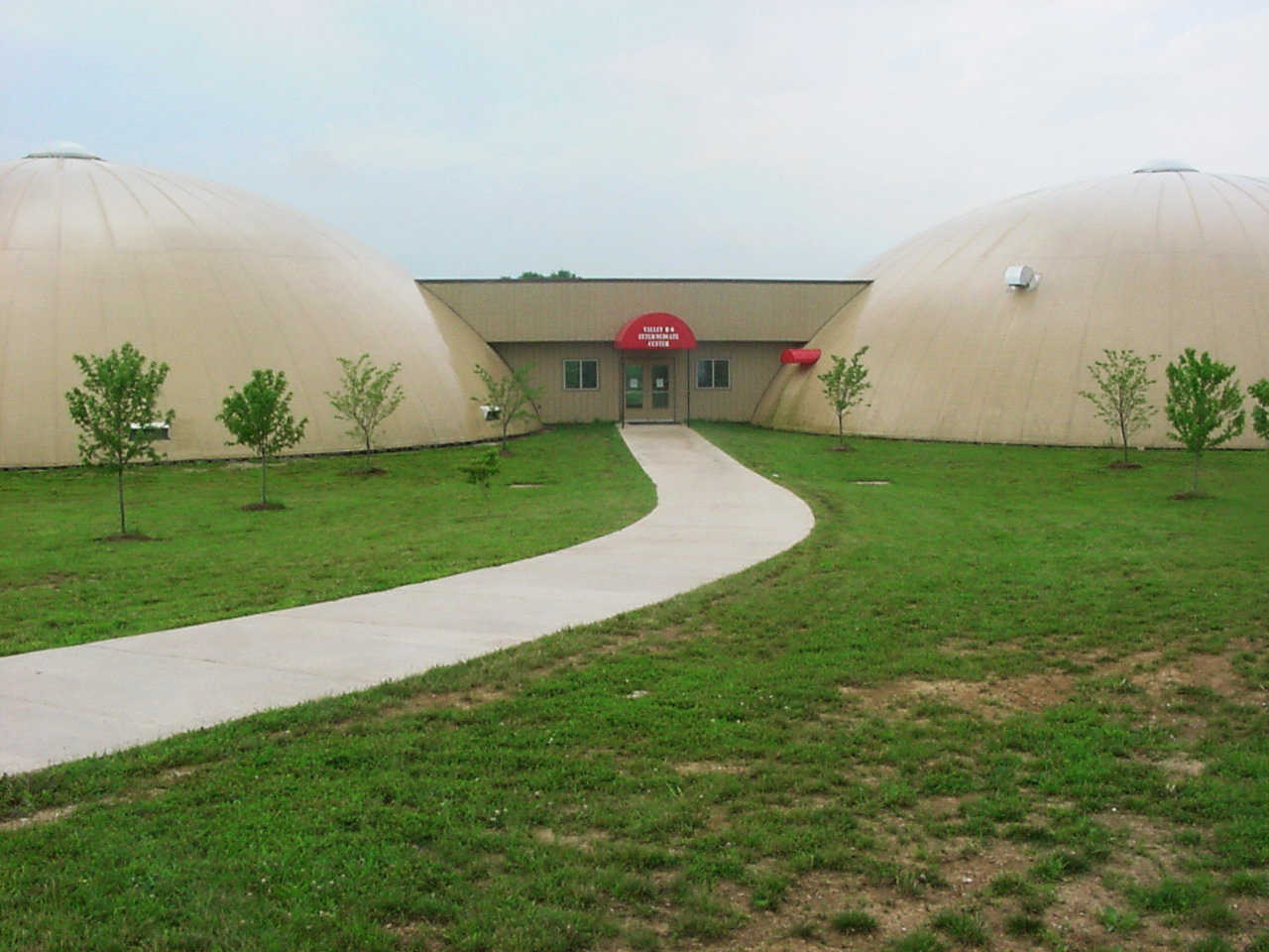 Monolithic Domes in Caledonia, Missouri — Voters approved a bond for construction of three Monolithic Domes, two to house classrooms for grades 3 through 6 and one as a gym.