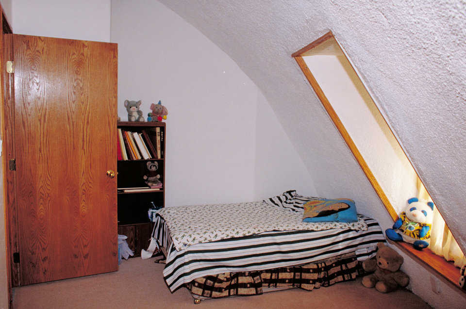Bedroom — This second-floor bedroom shows how usable the room is even though the dome wall comes in further.