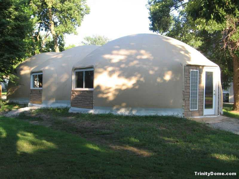 Trinity Dome — It has a Caterpillar-like design of three interconnected domes, each with a diameter of 24 feet, a height of 13 feet and a total area of 1232 square feet. Accent siding was installed below the north-side windows and the front entry. The stone look complements the Airform fabric.