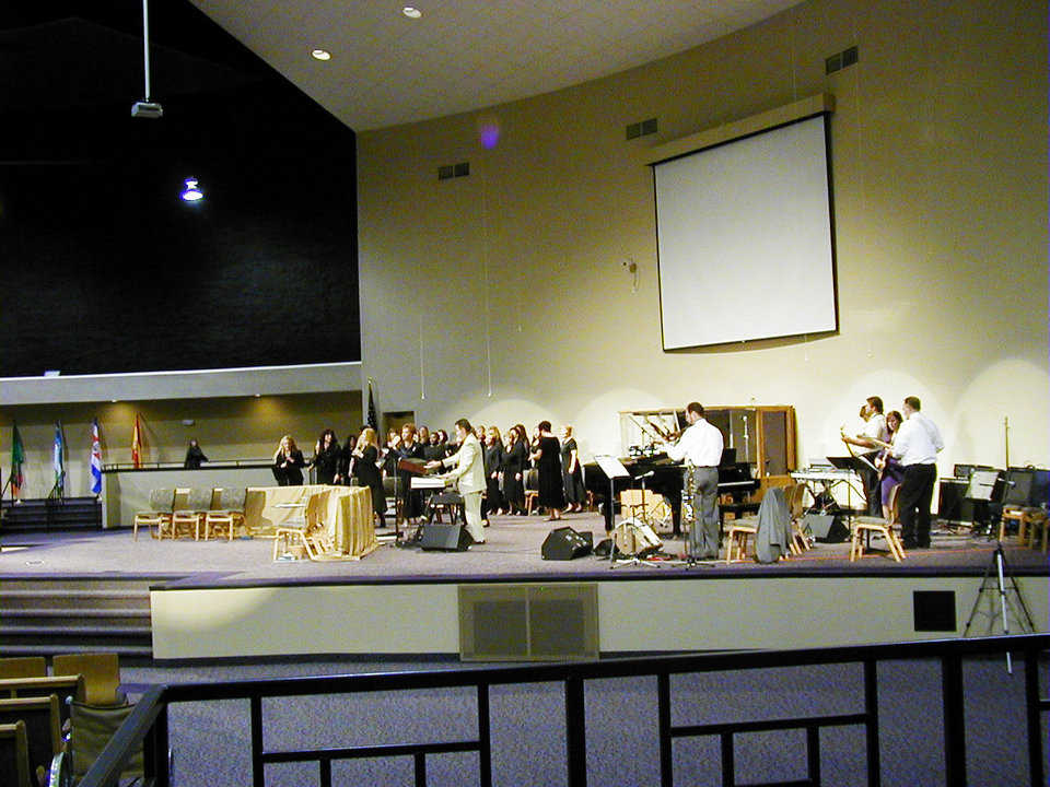 They love it! — Musicians and choir members love their new sanctuary and stage.
