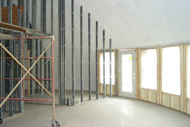 Interior Framing — Interior framing in a Monolithic Domes is not that much different than in conventional buildings.  We have wood studs for the exterior that have been insulated with polyurethane foam, and metal studs for the interior walls.