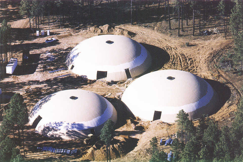 Aerial View — In 1998, the community completed three Monolithic Domes with an interconnecting central corridor.
