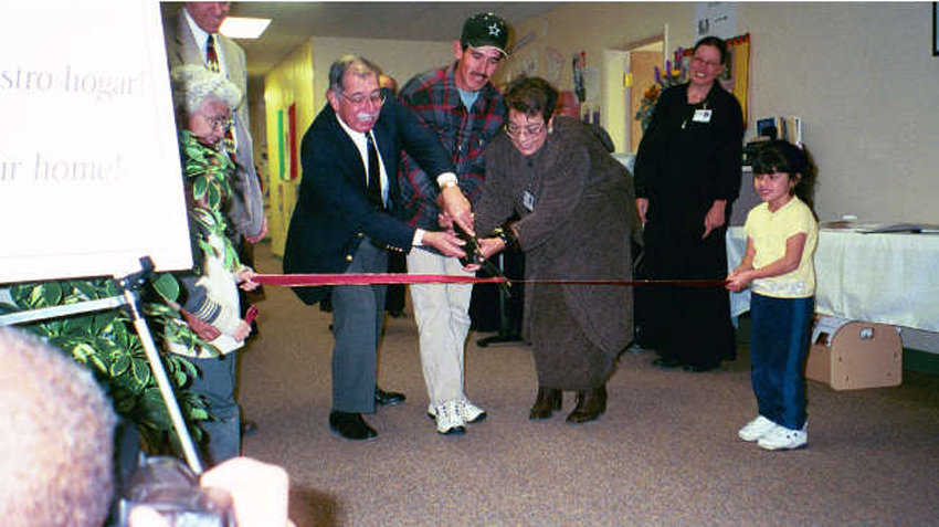 Grand Opening  — Children as well as directors participated in the ribbon cutting on opening day.