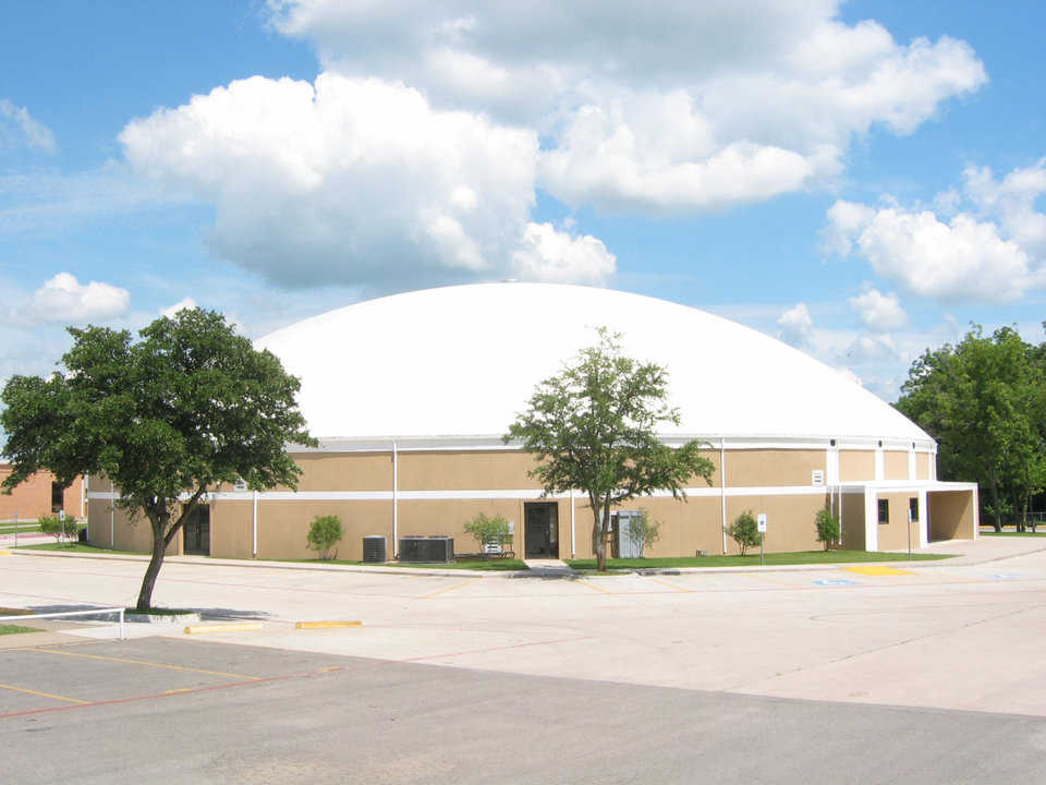 Gladiator Coliseum at Italy, Texas High School — This Monolithic Dome  has a diameter of 148 feet, two stories with seating for 1500, a gym with a walking track, an auditorium, classrooms for special activities, concession stands, ticket booths, locker rooms and bathrooms, and concrete parking areas. Its 2002 construction cost: $85 per square foot.