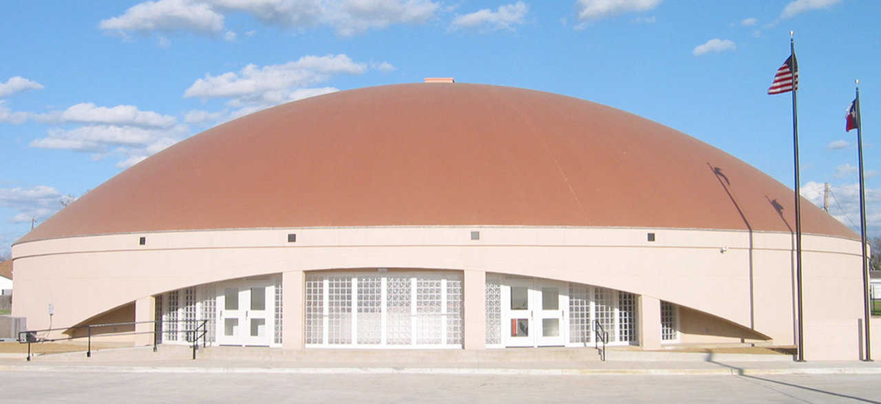 Avalon, Texas Multipurpose Center  — This Monolithic Dome gymnasium and center has a diameter of 124 feet and a height of 37 feet that includes a 12-foot-high stemwall.