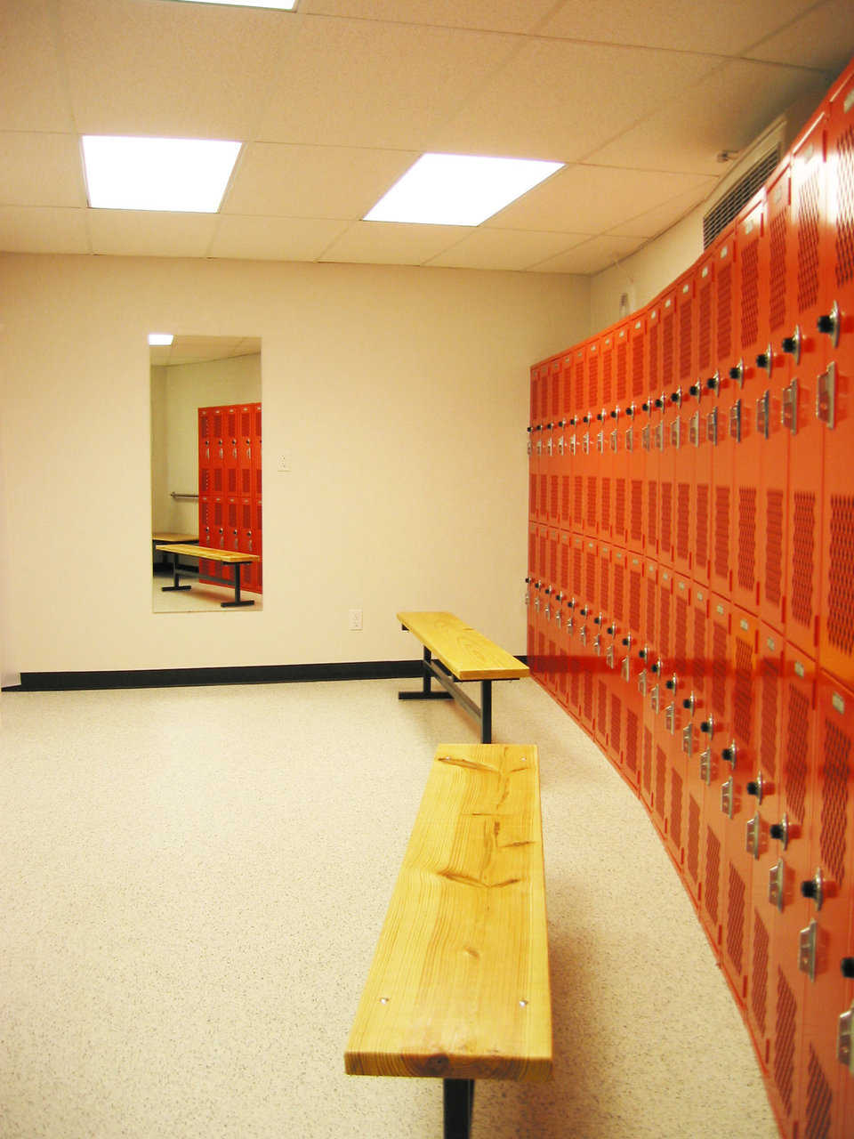 Neat storage — Large lockers outline the perimeter of the facility's four locker rooms.
