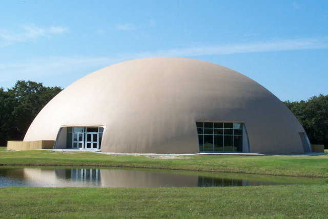 Thousand Oaks Ranch — It's a Monolithic Dome retreat center with a semi-elliptical shape, a 143-foot diameter and a 45-foot height in Barry, Texas.