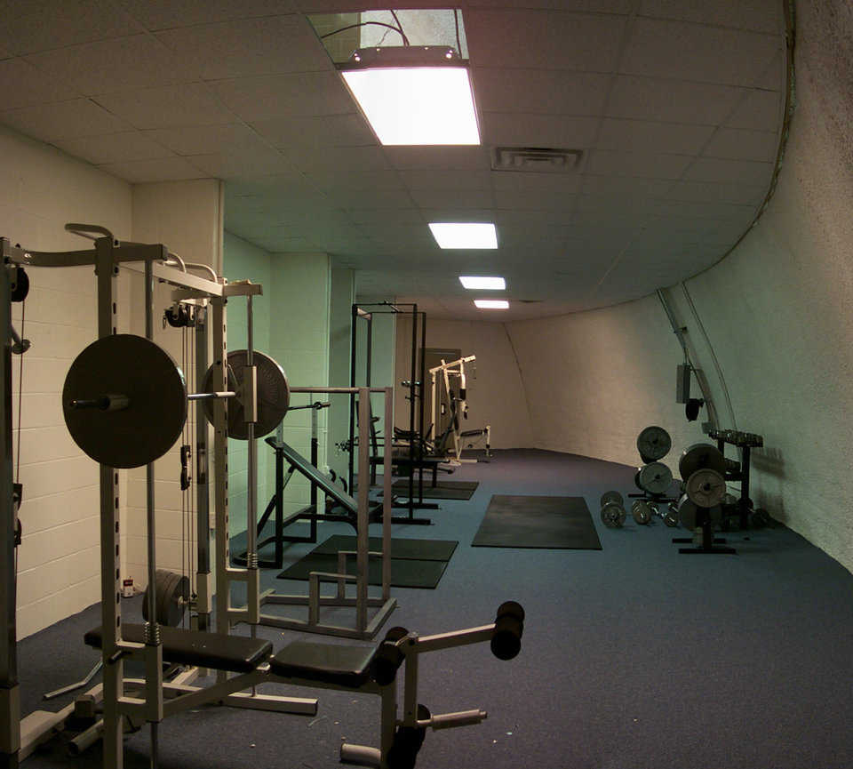 Weight lifting equipment — Well-utilized space behind the gym's walls houses weight lifting equipment.