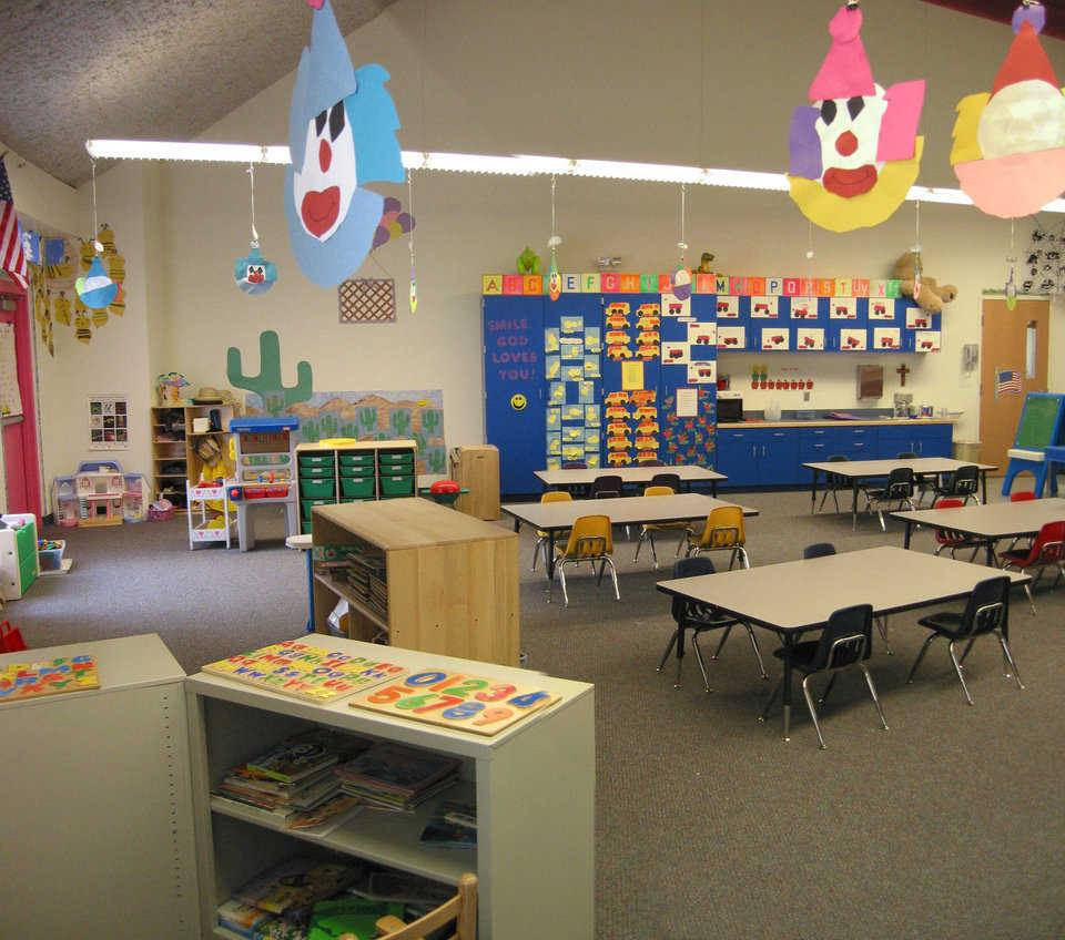 Bright and cheerful — Colorful clown faces hover over the work tables in this kindergarten.
