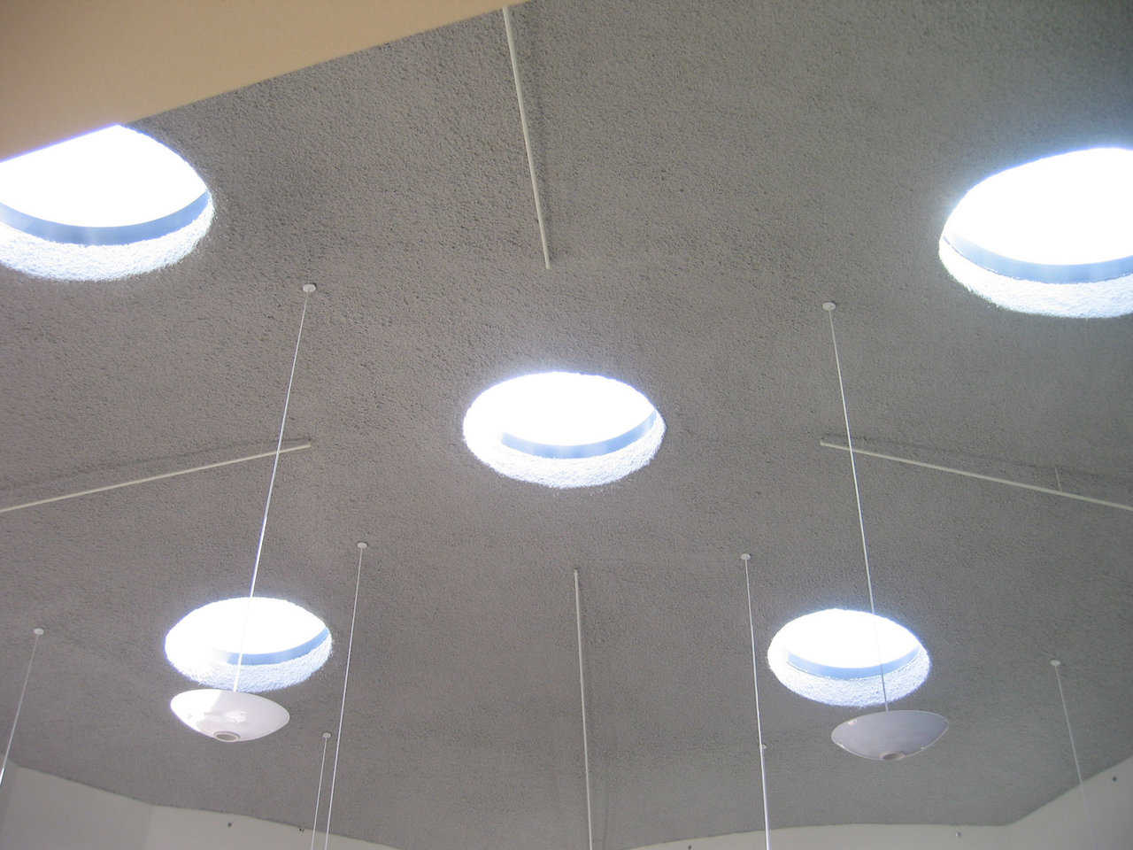 Let there be light! — The dome shell has inset skylights and hanging light fixtures.
