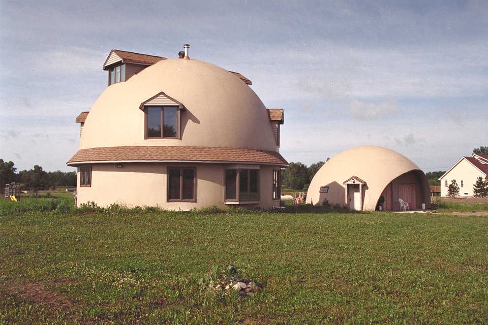 House built of credit cards — The two-dome home of the Gary E. Clark family of Ann Arbor, Michigan is a 36' hemisphere on an 18' stemwall, buried 9' into the ground.