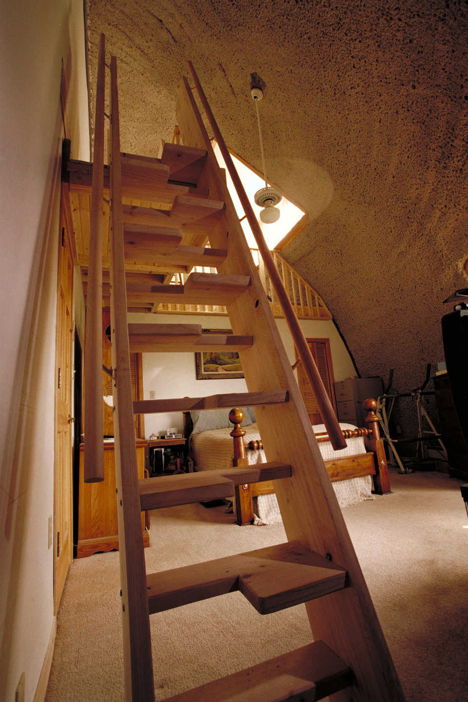 "Monk staircase — Width on each step alternates from left to right. This enables the staircase to be much steeper, almost like a ladder, and still ""feel"" like a regular staircase when climbing or descending."