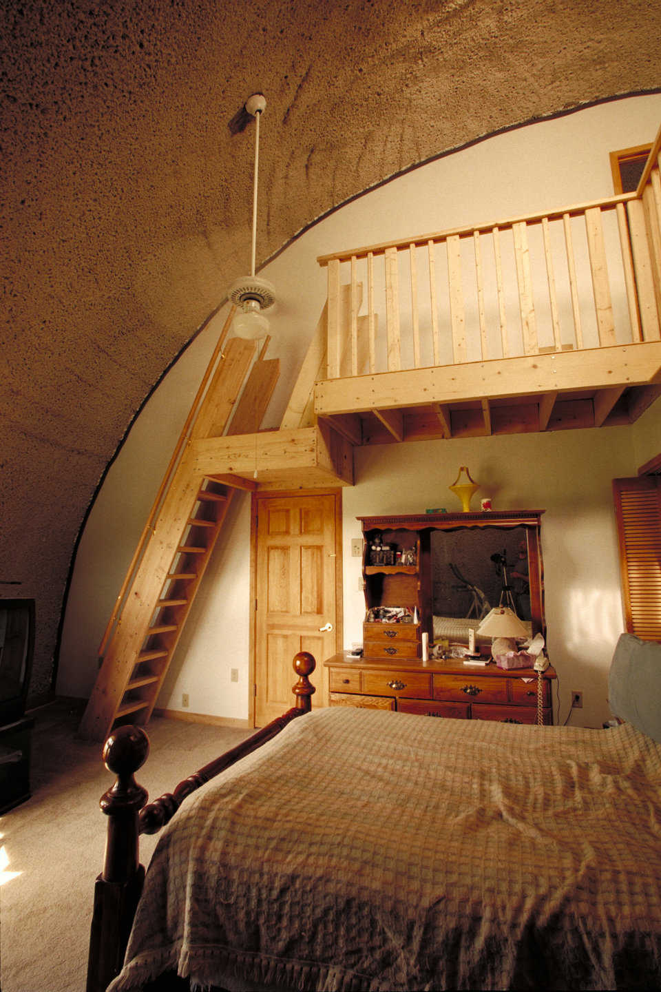 Bedroom — Master bedroom has an 18-foot-high ceiling. A monk staircase leads to a L-shaped, 250-square-foot study.
